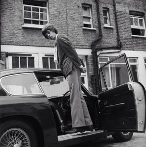 Mick-Jagger-his-snazzy-Aston-DB6-19663