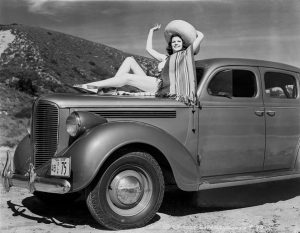 Rita Hayworth & Dodge D8 1938